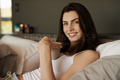 Buy stock photo Shot of a beautiful young woman having coffee in bed in the morning at home