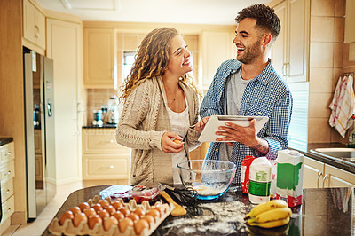 Buy stock photo Shot of a loving couple baking in their kitchen