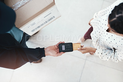 Buy stock photo High angle shot of an unrecognizable delivery man receiving payment from a female customer for her order