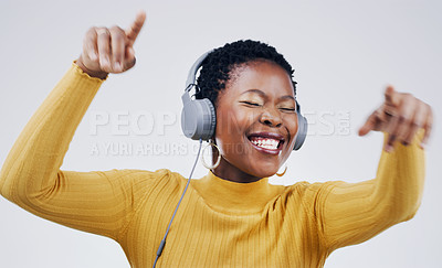 Buy stock photo Studio shot of an attractive young woman dancing against a grey background