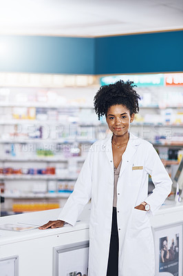 Buy stock photo Portrait of a female pharmacist standing in a chemist
