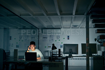 Buy stock photo Shot of a young businessman looking stressed during a late night in a modern office