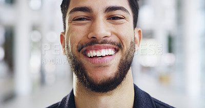 Buy stock photo Cropped shot of a young handsome businessman in a modern office