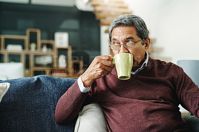 Buy stock photo Cropped shot of a mature man relaxing with a cup of coffee on the sofa at home