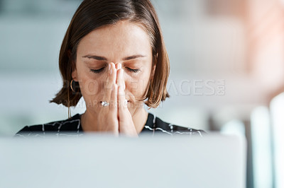 Buy stock photo Cropped shot of young businesswoman with hands clasped in prayer while working in an office