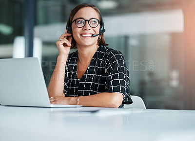 Buy stock photo Cropped shot of a happy young call centre agent working on a laptop in an office