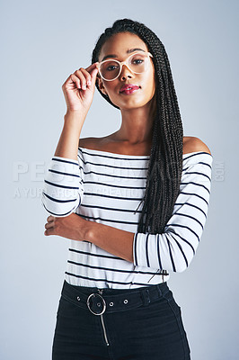 Buy stock photo Cropped shot of a beautiful young woman posing against a grey background
