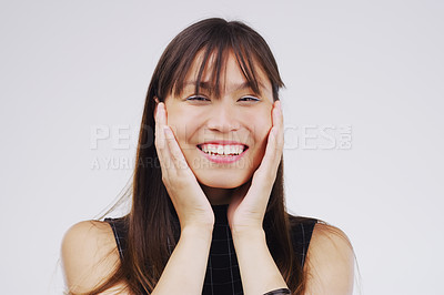 Buy stock photo Studio portrait of an attractive young woman looking surprised against a grey background