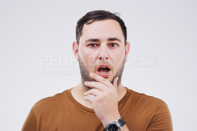 Buy stock photo Studio portrait of a handsome young man looking shocked against a grey background