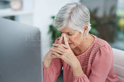 Buy stock photo Shot of a mature woman looking stressed out in her office at work