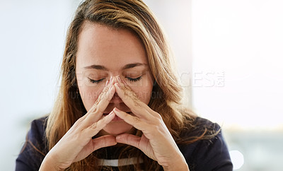 Buy stock photo Shot of an attractive businesswoman looking overly stressed out in her office at work