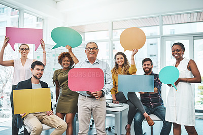 Buy stock photo Portrait of a group of businesspeople holding speech bubbles in an office