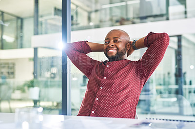 Buy stock photo Shot of a young designer taking a break while working in an office