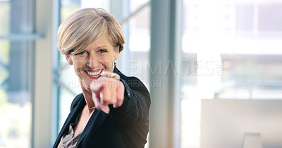 Buy stock photo Portrait of a mature businesswoman pointing to the camera in an office