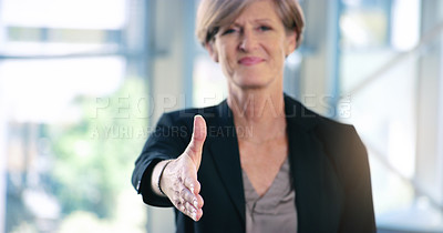 Buy stock photo Portrait of a mature businesswoman extending a handshake in an office