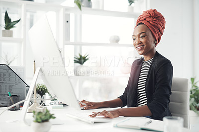 Buy stock photo Cropped shot of an attractive young businesswoman working at her desk in the office