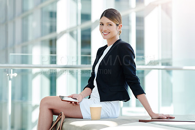 Buy stock photo Cropped portrait of an attractive young businesswoman smiling while using a smartphone in a waiting room