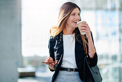 Buy stock photo Cropped shot of an attractive young businesswoman having coffee in her workplace