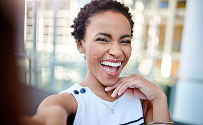 Buy stock photo Cropped portrait of an attractive young woman taking a selfie in the workplace