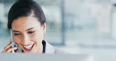 Buy stock photo Cropped shot of a cheerful young businesswoman talking on her cellphone while being seated in the office during the day