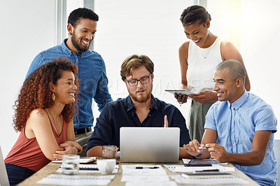 Buy stock photo Cropped shot of a group of work colleagues having a meeting together inside of the office