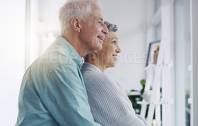 Buy stock photo Shot of a happy senior couple embracing at home