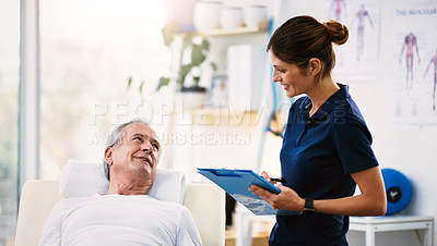 Buy stock photo Shot of a young female physiotherapist doing a consultation and assessment of a senior patient