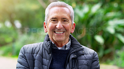 Buy stock photo Cropped shot of a cheerful elderly man seated on a bench outside in a park during the day