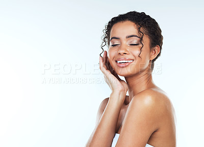 Buy stock photo Studio shot of an attractive young woman posing against a white background