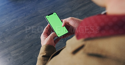 Buy stock photo Over the shoulder shot of an unrecognizable man texting on his cellphone inside of a building