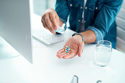 Buy stock photo Shot of an unrecognizable businessman taking his medication in his office