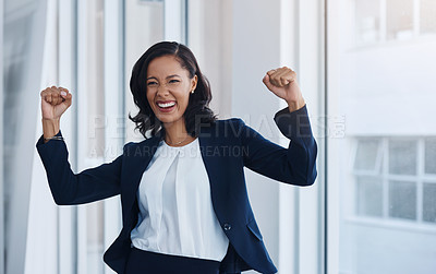 Buy stock photo Shot of a young businesswoman cheering in an office