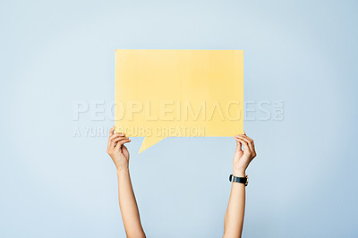 Buy stock photo Shot of an unrecognizable woman holding up a speech bubble against a blue background