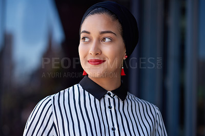 Buy stock photo Shot of a confident young businesswoman standing on the balcony of a modern office and looking thoughtful
