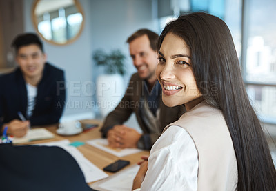 Buy stock photo Portrait of a young businesswoman sitting in a meeting in an office