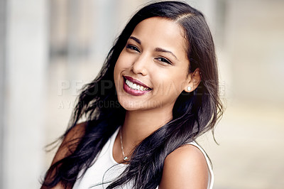 Buy stock photo Cropped portrait of an attractive young businesswoman standing outside