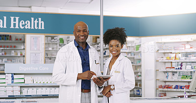 Buy stock photo Cropped portrait of two pharmacists using a digital tablet together in a chemist