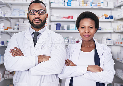 Buy stock photo Portrait of two pharmacists standing with their arms crossed in a chemist