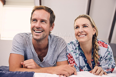 Buy stock photo Shot of a beautiful young couple spending some together at home