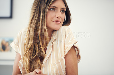 Buy stock photo Cropped shot of an attractive woman looking thoughtful at home