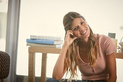 Buy stock photo Cropped shot of an attractive woman spending the day at home