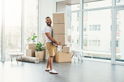 Buy stock photo Portrait of a young man carrying a pile of boxes while moving house