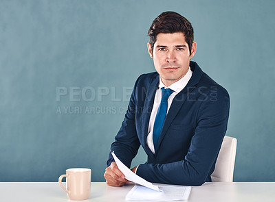 Buy stock photo Cropped portrait of a handsome young male newscaster sitting in the newsroom