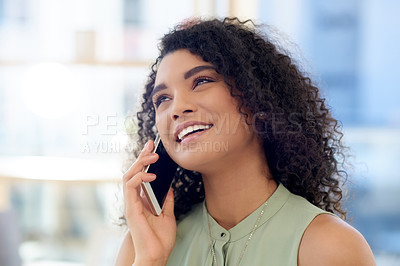Buy stock photo Cropped shot of an attractive young businesswoman looking thoughtful while making a phonecall while working in her office