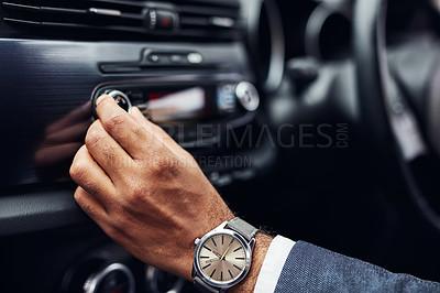 Buy stock photo Cropped shot of a man tuning his car radio