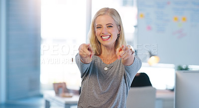 Buy stock photo Portrait of a confident young businesswoman pointing at the camera with both of her hands inside of the office