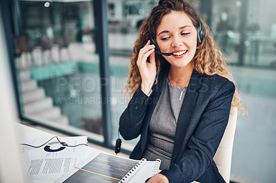 Buy stock photo Shot of a young businesswoman working in a call centre