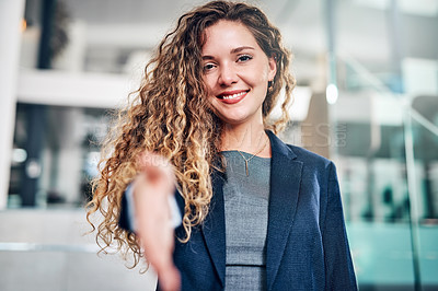 Buy stock photo Portrait of a young businesswoman extending a handshake in an office