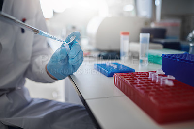 Buy stock photo Cropped shot of a scientist conducting an experiment in a modern laboratory