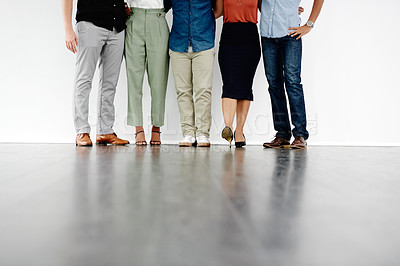 Buy stock photo Shot of a group of unrecognizable businesspeople waiting in line for an interview against a white background